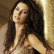 Singer Shania Twain in Beige and Gold Gown